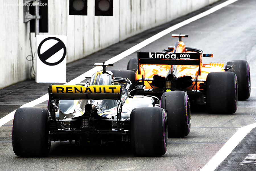 Fernando Alonso (ESP) McLaren MCL33 leads Nico Hulkenberg (GER) Renault Sport F1 Team RS18 out of the pits.