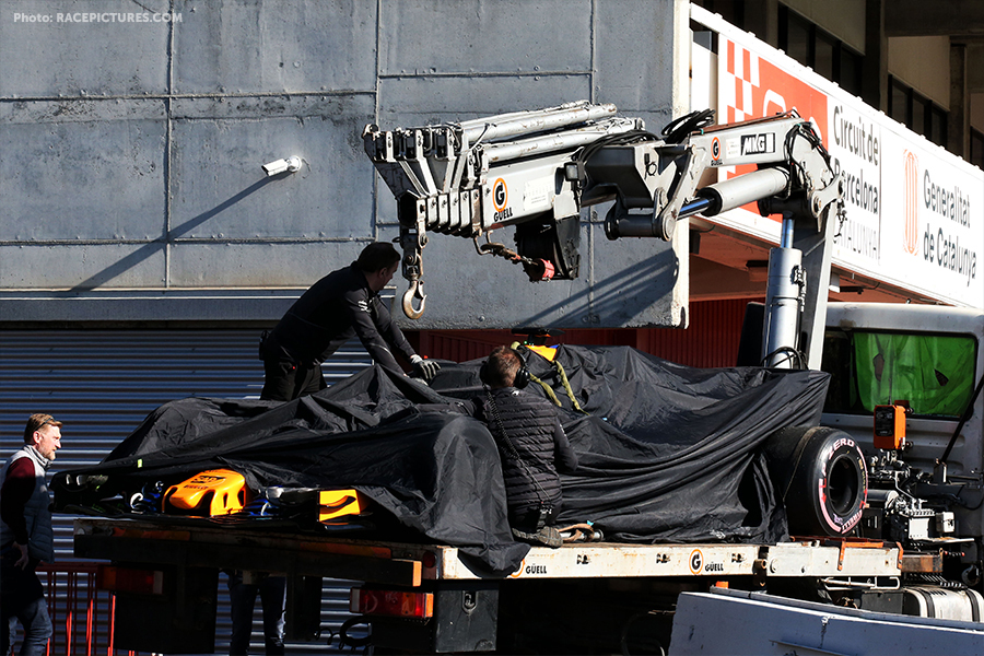 The McLaren MCL33 of Fernando Alonso (ESP) McLaren is recovered back to the pits on the back of a truck.