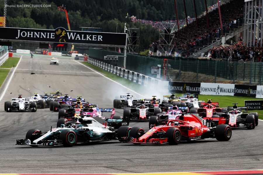 Lewis Hamilton (GBR) Mercedes AMG F1 W09 and Sebastian Vettel (GER) Ferrari SF71H lead at the start of the race.