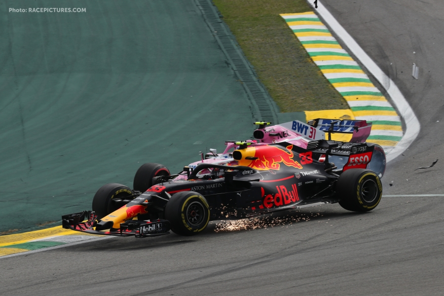 Max Verstappen (NLD) Red Bull Racing RB14 and Esteban Ocon (FRA) Racing Point Force India F1 VJM11 collide.