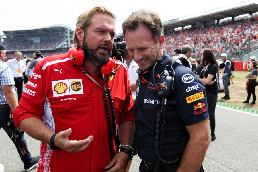 L to R): Gino Rosato (CDN) Ferrari with Christian Horner (GBR) Red Bull Racing Team Principal on the grid.