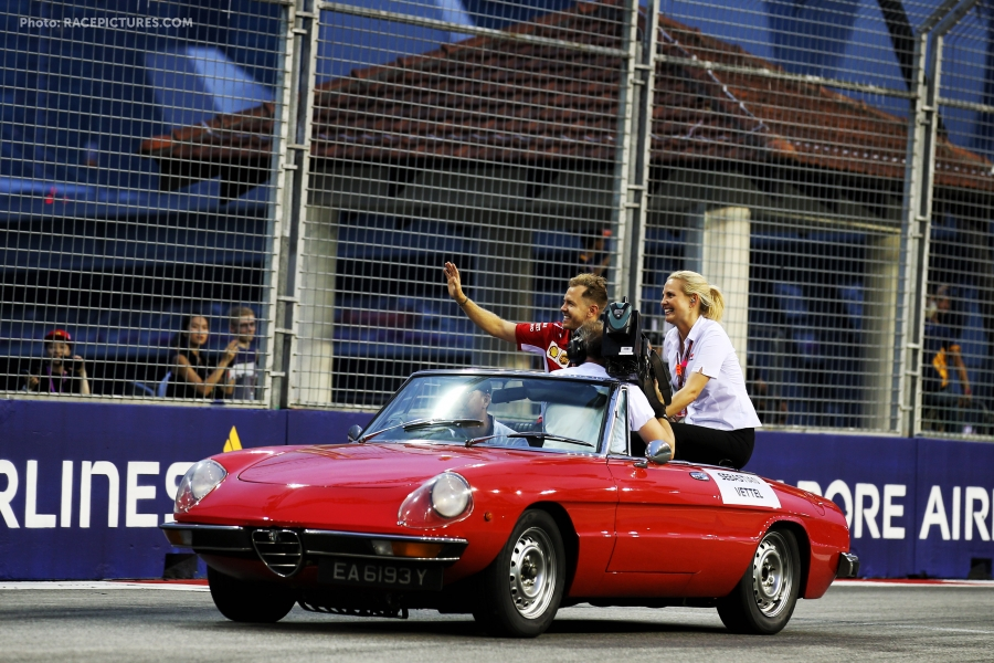 Sebastian Vettel (GER) Ferrari with Rachel Brookes (GBR) Sky Sports F1 Reporter on the drivers parade.