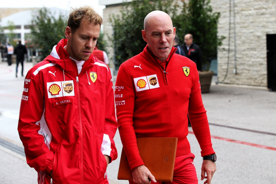Sebastian Vettel (GER) Ferrari with Jock Clear (GBR) Ferrari Engineering Director.